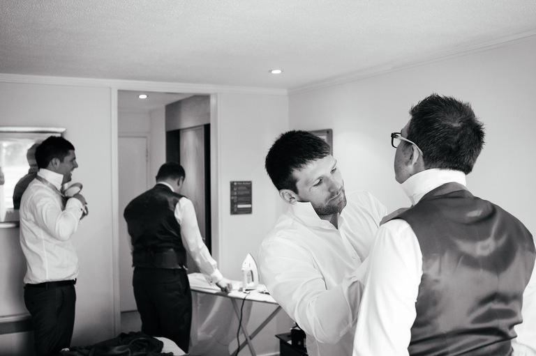 groom prep fixing tie