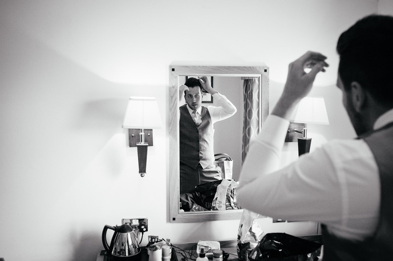 groom mirror styling hair