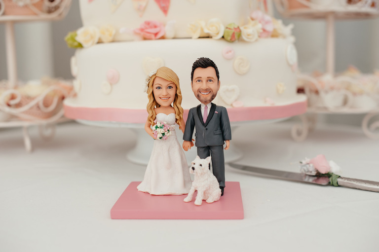 lifelike wedding cake toppers of bride groom