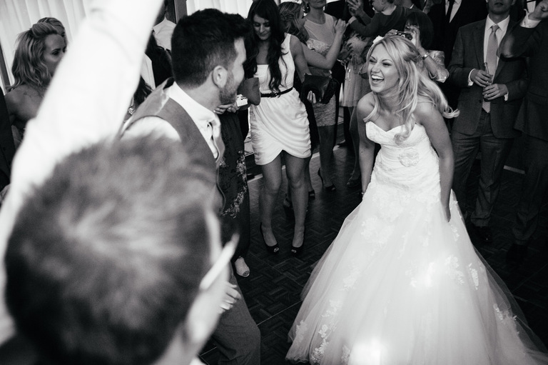 happy bride groom dancing