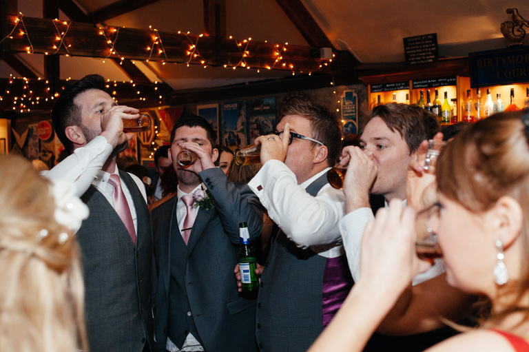 wedding guests doing shots