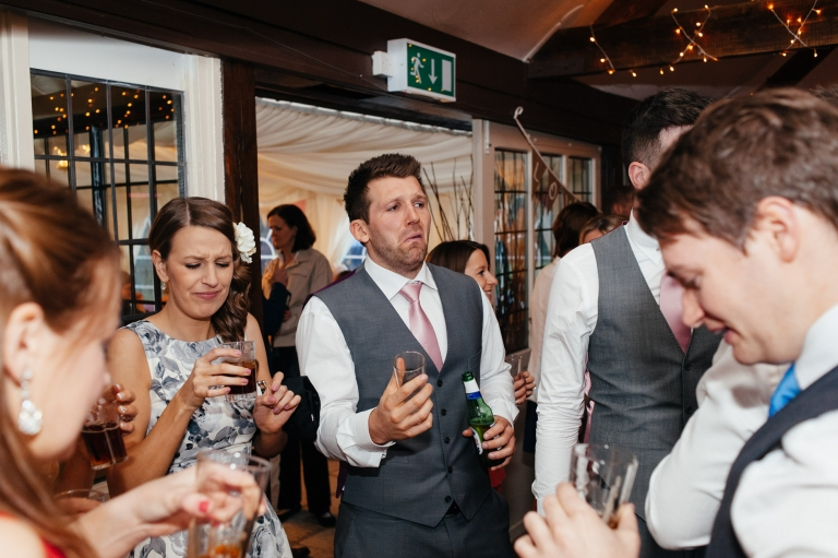 best man alcohol pulls face