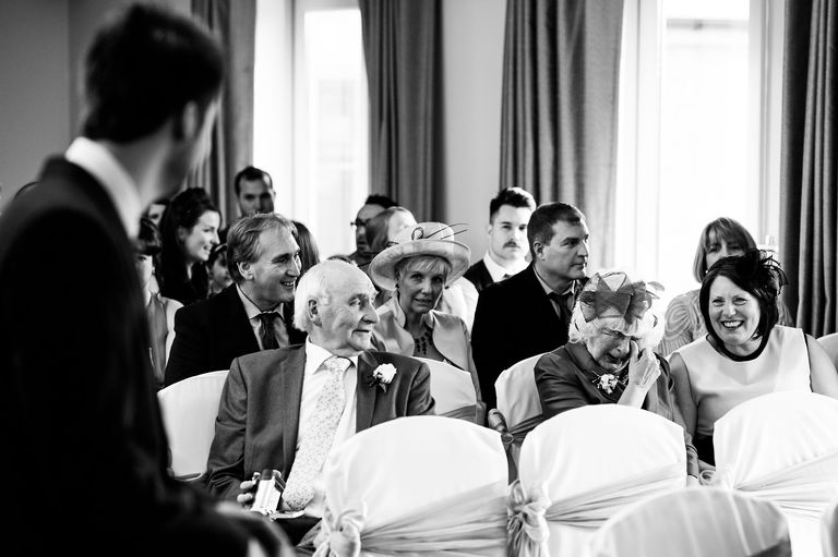 laughing and crying wedding guests