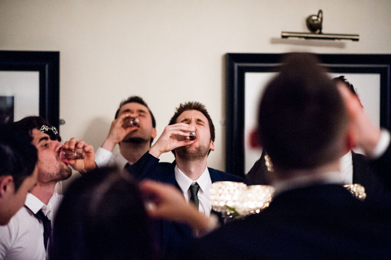 groom drinking tequila shots