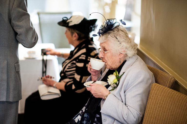 elderly wedding guest cup of tea