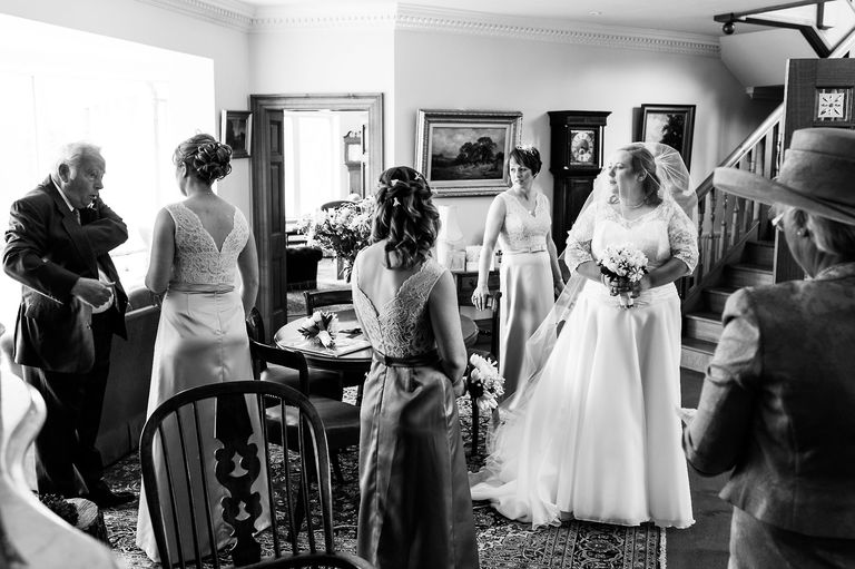 bride and bridesmaids at her parents house