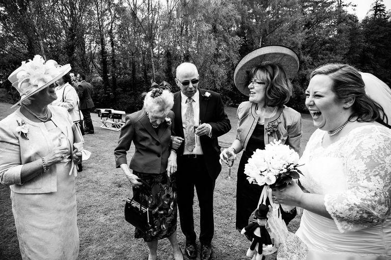 sharing a joke during a wedding