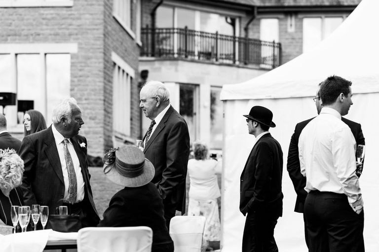 man in bowler hat at a wedding