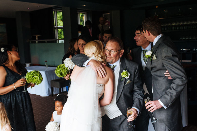 bride receiving a hug off her father