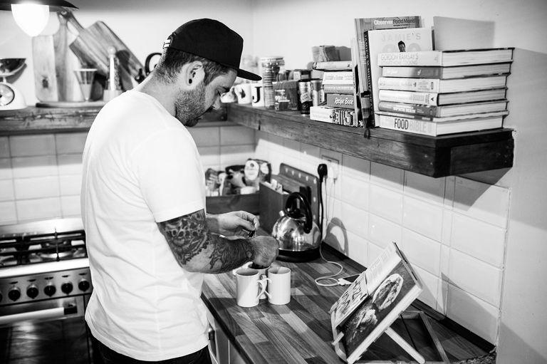 tattooed groom making cup of tea wedding morning