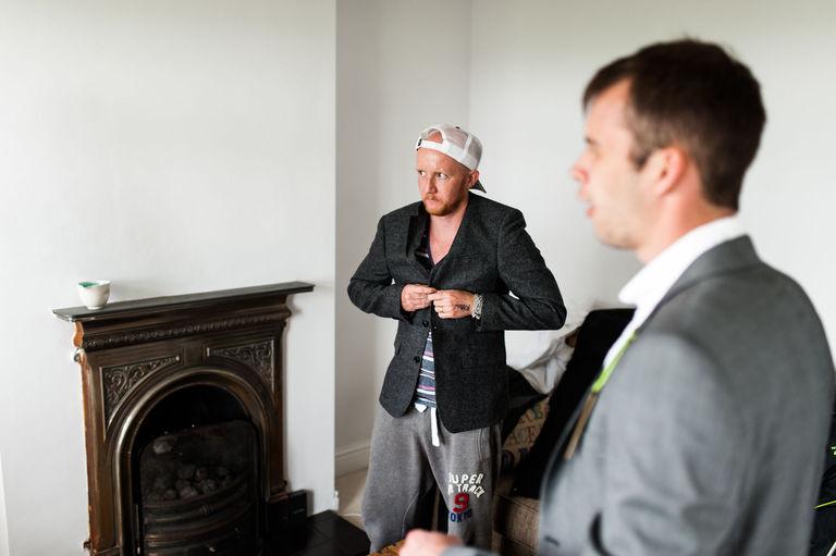 baseball cap suit jacket wedding morning