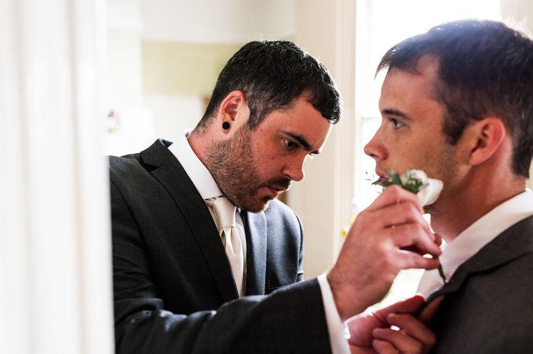 groom fitting flowers