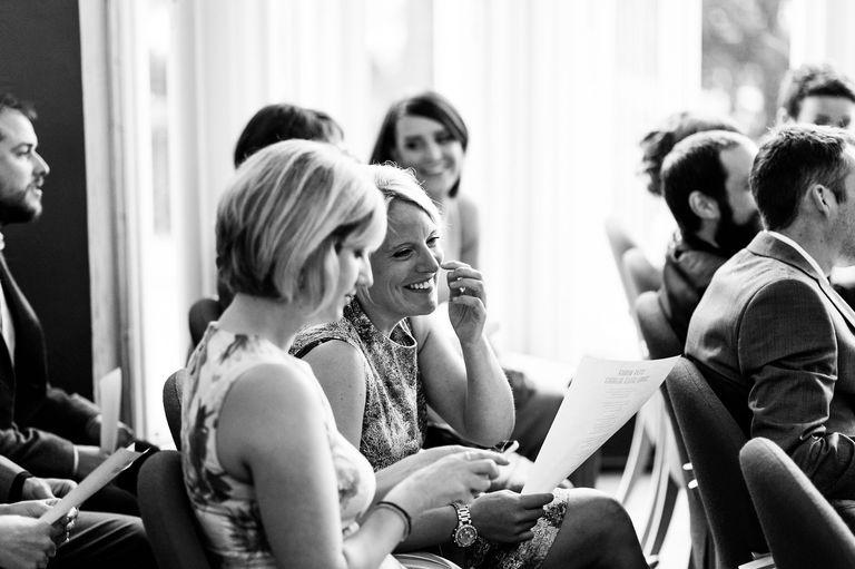 ladies laughing at wedding ceremony