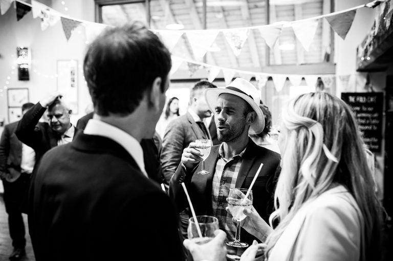 man at a wedding in ladies hat