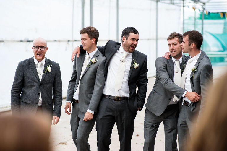 groom hanging out with groomsmen