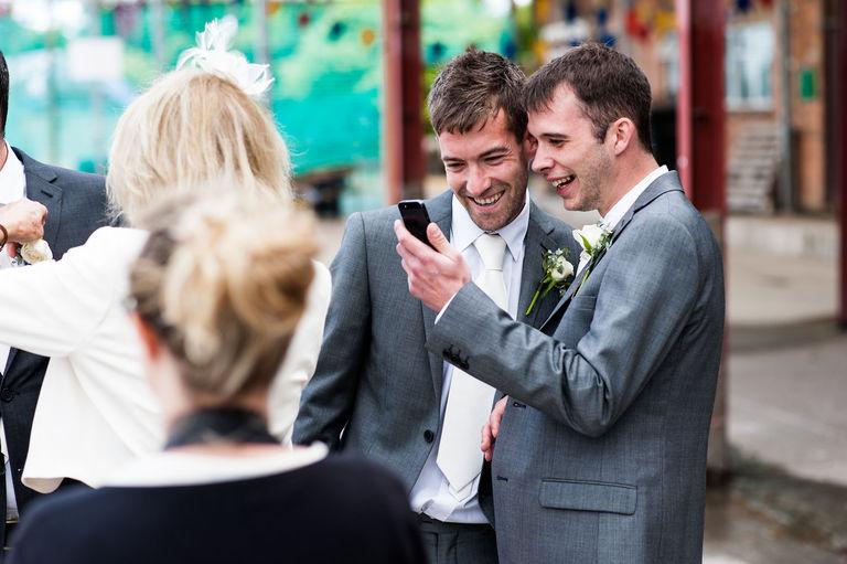 groomsmen looking at phone