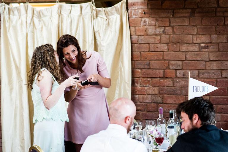 wedding guests sharing a joke