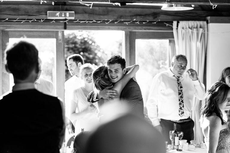 best man hugging bridesmaid