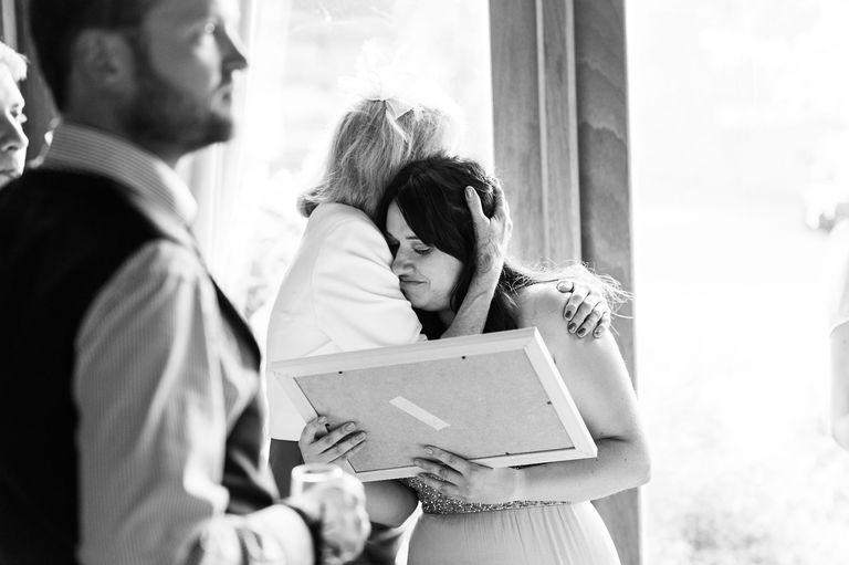 emotional hug after wedding speeches
