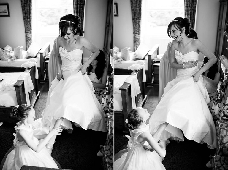 bridesmaids putting brides shoes on
