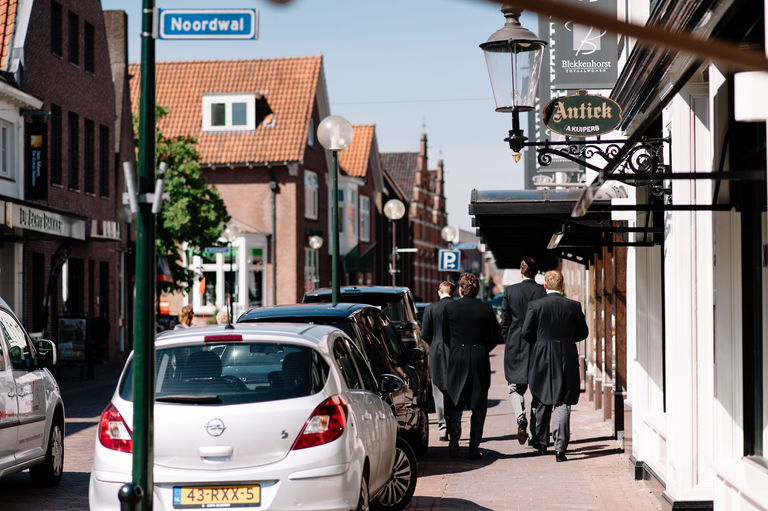 groomsmen walking streets of delden netherlands
