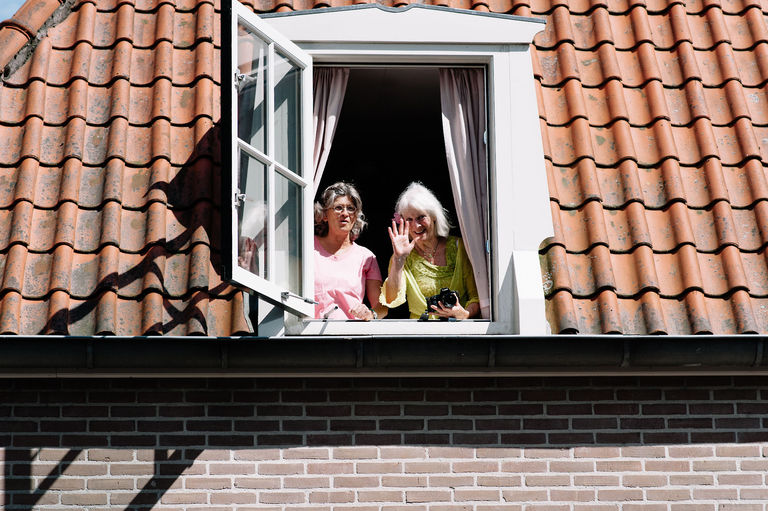 residents watching from their window for the wedding