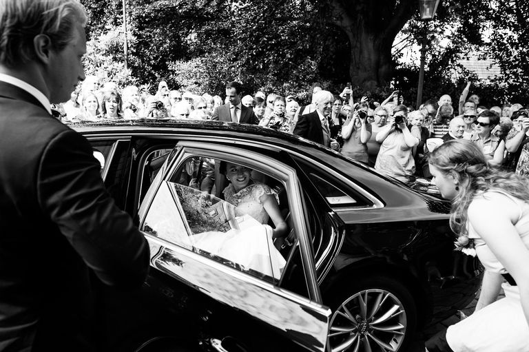 bride arrives at church in delden