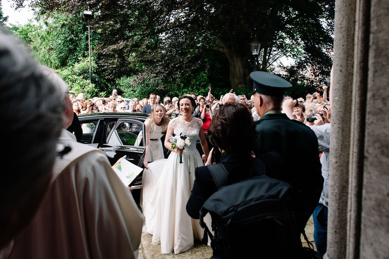 bride arrives at church to local residents