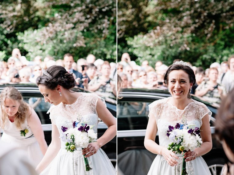 bride arriving at church with bouquet