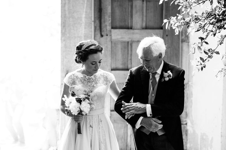 tender moment between bride and her father