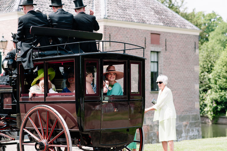 guests arrive by carriage