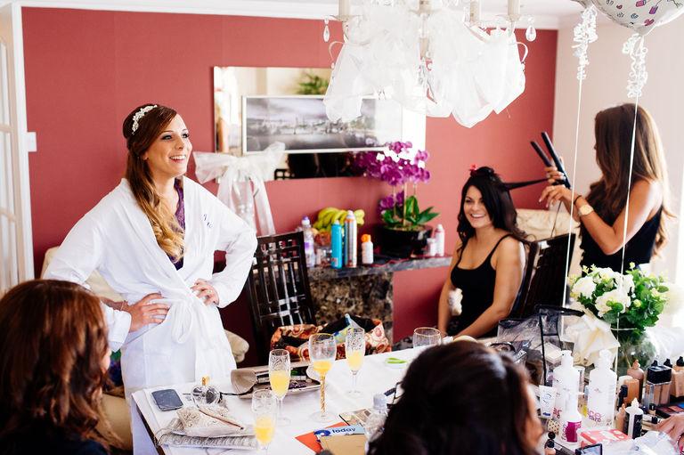 wedding morning prep happy looking bride