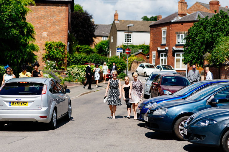 guests walking to wedding summers day