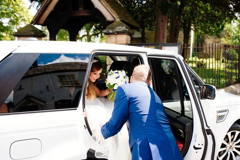 bride arriving church white range rover