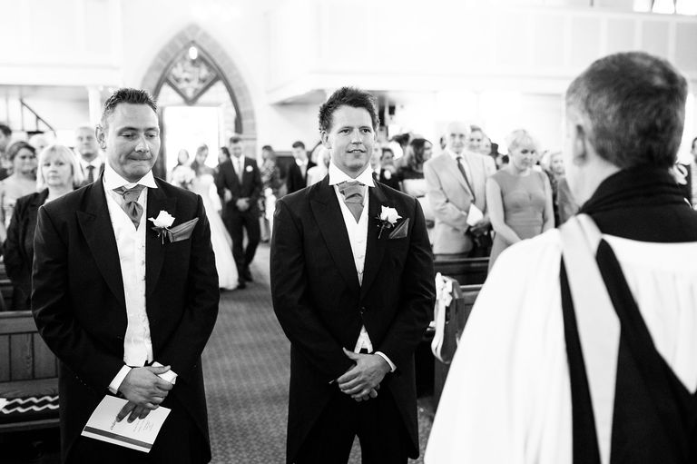 groom waiting at the altar bride behind him