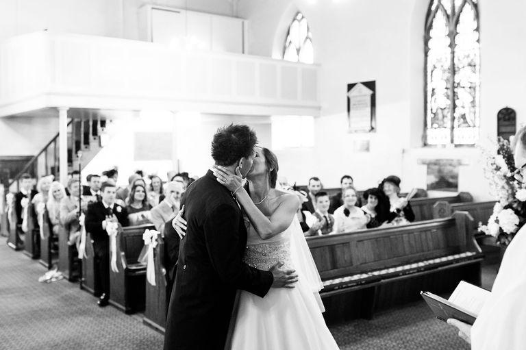 wedding first kiss in church