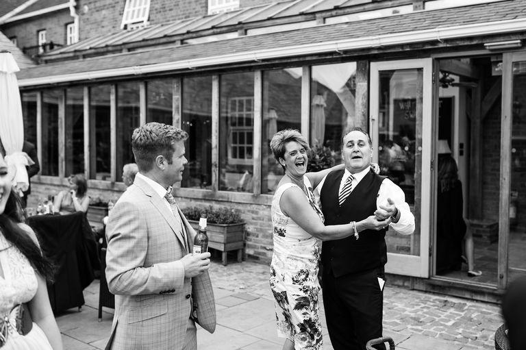 dancing outside at a summer wedding