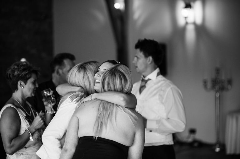 bride hugging best friends