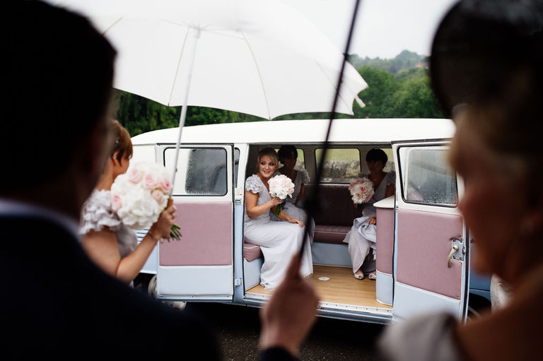 bridesmaids arriving at church in camper van
