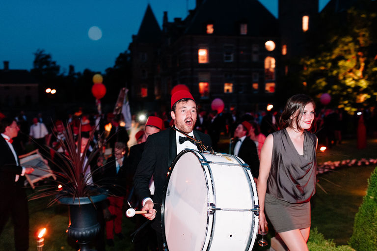 wedding guests form marching band