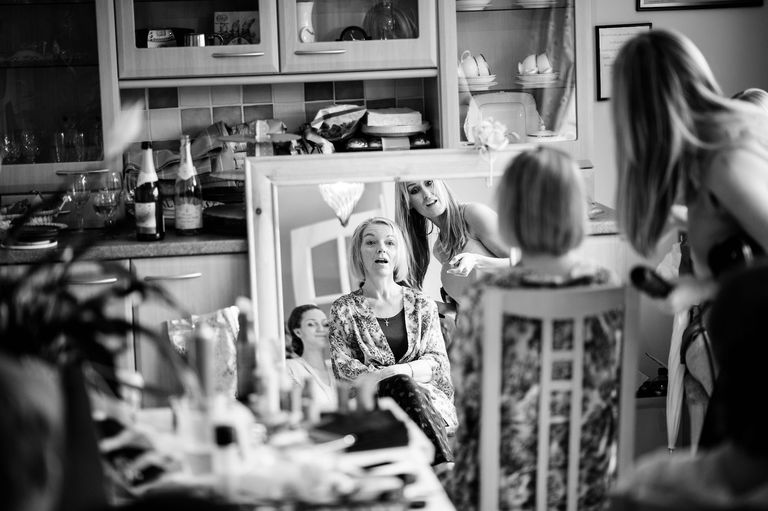 Mother of the bride having make up done