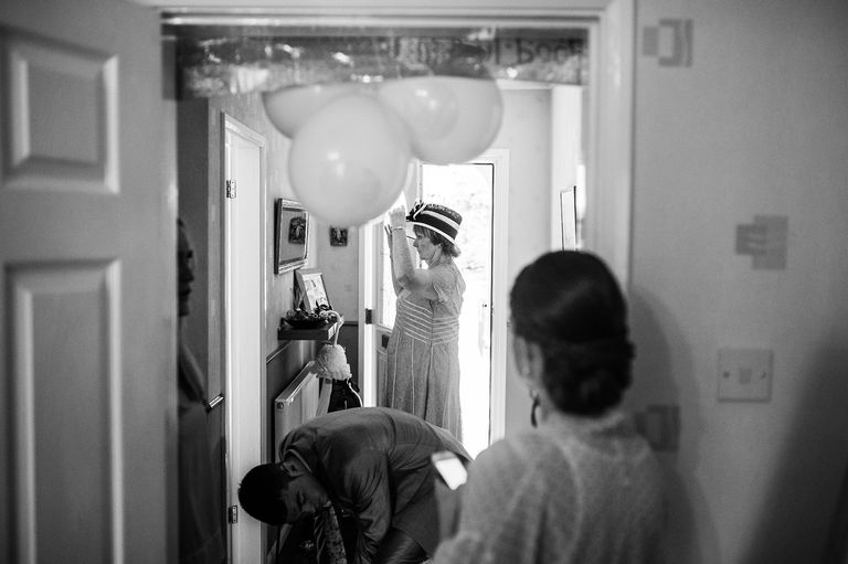 Grandma putting on her wedding hat