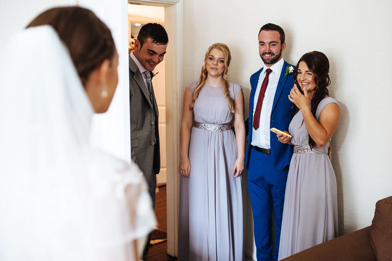 Bride's family see her in her dress for the first time