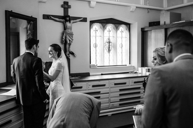 Bride and groom in the back of the church