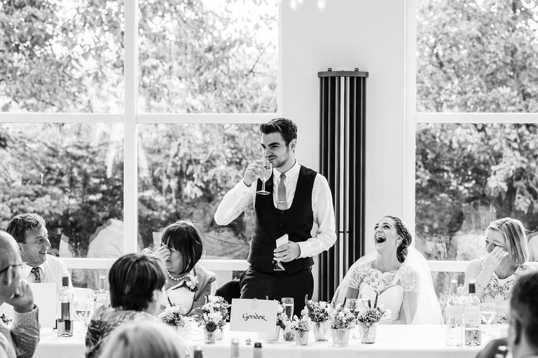 Groom tells a joke in his speech