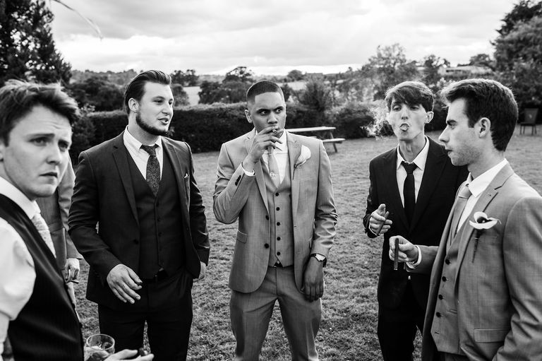 Groom's friends smoking cigars