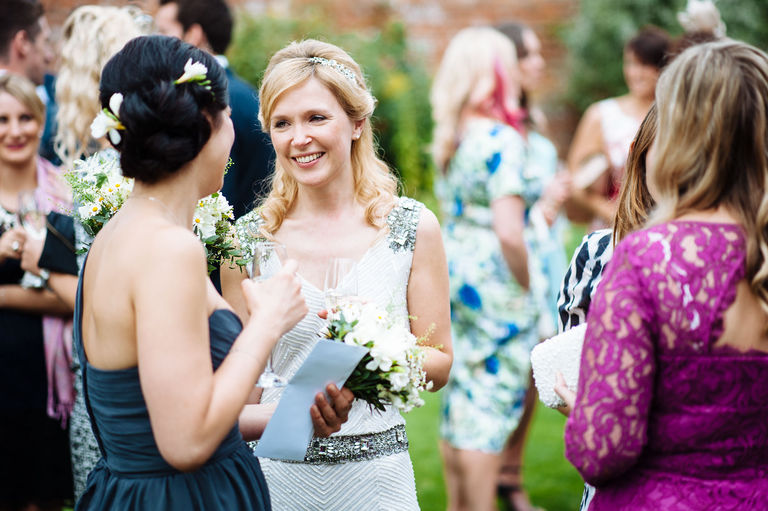 Happy bride talks with guests