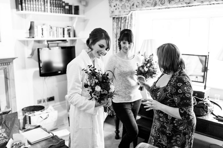 Bride admiring wedding flowers