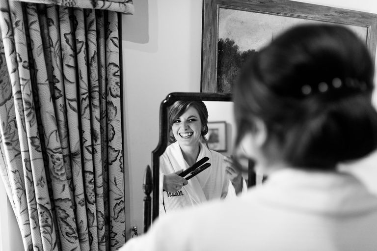 Smiling bride reflection