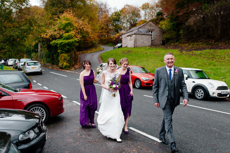 Bride walks to the church in Whitewell